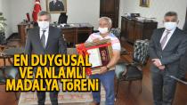 Karaman'da şehit ailelerine devletten madalya